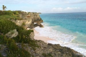 sea shore bermuda oceanside seashore sunset ocean rocks sea