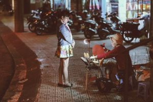 seat vendor people motorcycles lady woman chair pavement street city