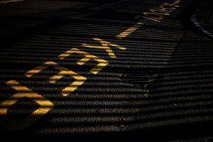 shadows yellow road marking road light black