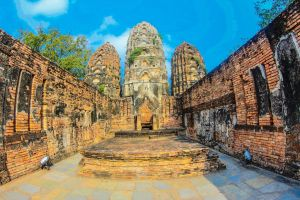 siam ruin world destination ancient blue tropical sculpture looking temple