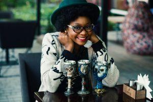 smiling outdoorchallenge pretty beauty goblets eyewear sitting beautiful woman