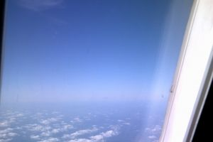 soaring flying up in life blue skies over the usa above the clouds airplane