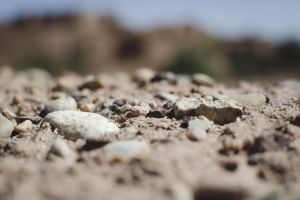 stones blurred background rough surface earth daylight sand land texture dry