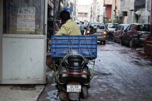 street india delhi scooter sitting