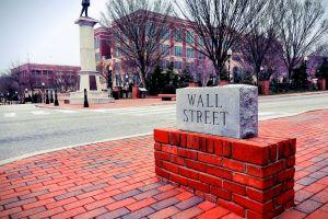 street statue buildings road bricks monument red bricks pave\ment landmark trees