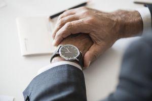 style finger wristwatch close-up focus hands blur urgency conceptual time