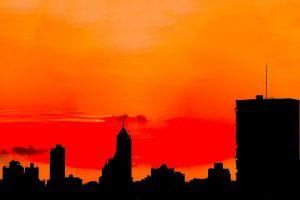 sunset dawn sky buildings backlit skyline skyscrapers