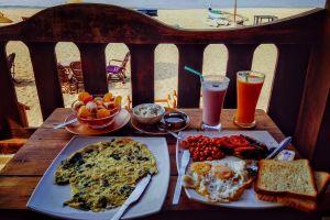 tableware wood fruit shake meal knives egg meat food straws drinks