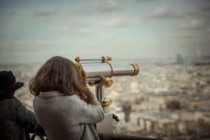 telescope person buildings woman city daytime
