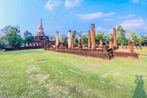 temple oriental asia religion ruins grass ancient architecture clouds historical