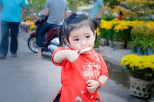 toddler street girl baby daylight eating park child people young