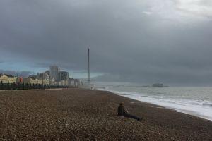 tower stones pier brighton beach stormy solo raining