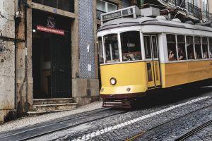 train public transport cable car daylight people tram lines transportation system urban locomotive commuters