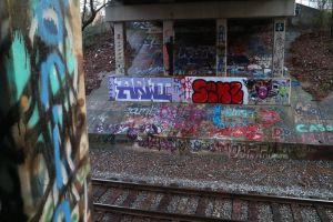 train tracks gravel colors bridge art graffiti