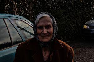 vehicle girl grandma transportation system fashion light rain adult woman person