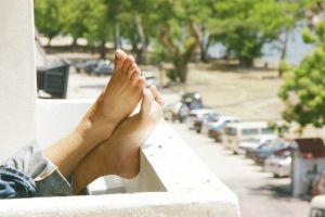 vehicles relaxing toes daytime cars person blur transportation system daylight trees