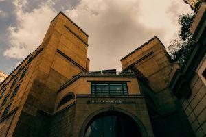 vintage design building archaic architecture architectural design clouds tones