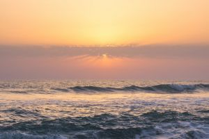 water beach sun waves sunrise horizon
