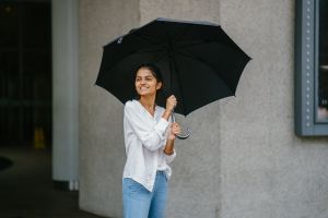 wear pretty outfit natural lifestyle standing smile umbrella looking daylight