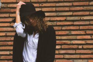 wear woman hat street pose brickwall wall girl fashion bricks