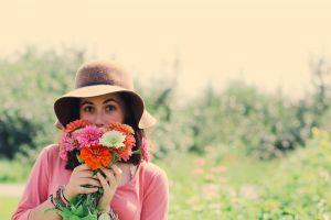 woman fresh flowers blur fun flowers joy grass park pretty sun