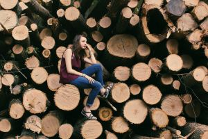 wood logs wood woman female pile pose wooden logs woodpile timber wooden