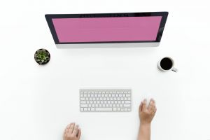 workplace woman desk communication blank laptop keyboard flatlay office screen