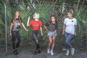 young pose group together wear girls together chain link fence friendship people women