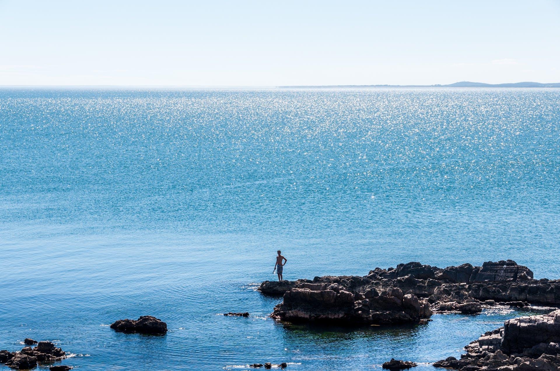 fishing sea blue water rocks