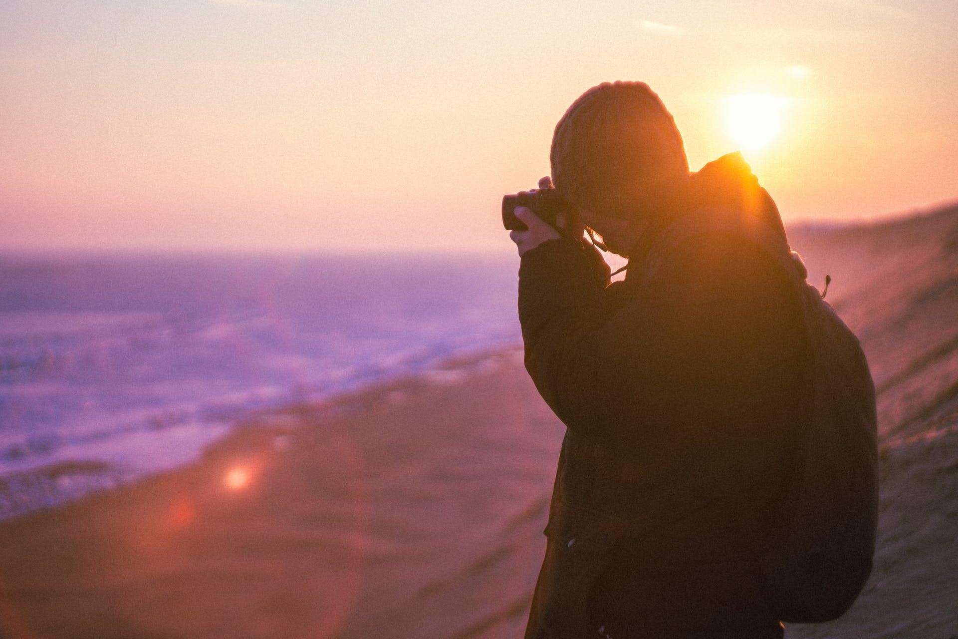 sunrise beach calm scenery peaceful scenic sunset ocean dawn person
