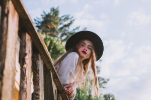 beautiful focus blur woman wooden railing wear attractive hair person female