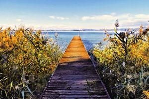 blue water idyllic idyll color in water boat water silence lake garda italy jetty