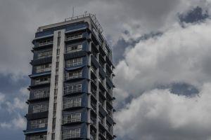 clouds form apartment building blue sky architectural design windows city city lights architect architecture