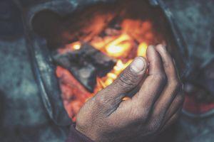 delhicold slums bonfire woodfire fire palm on fire winter hand india poverty