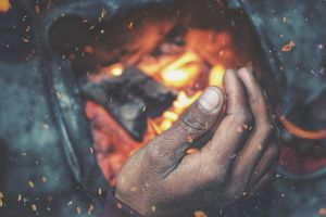 fire slums hand on fire poverty bonfire india winter cold