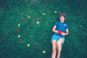 flower arrangement joyful adobe photoshop photographers pretty grassy hair girl lying down grass field