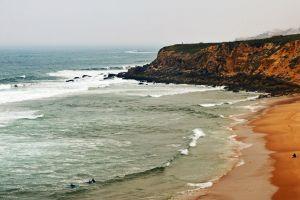 foggy morning surf praia beach