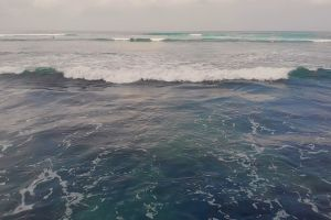 from above horizon bali drone shot waves ocean beach sea drone footage
