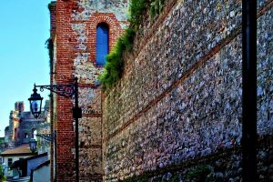 holiday lantern grass resort wall historic center architecture red brick stones italy