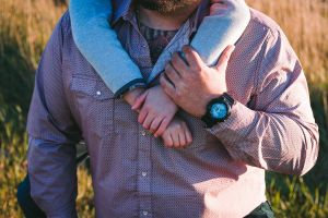 jewelry father father and son family love hug father and child field purple yellow
