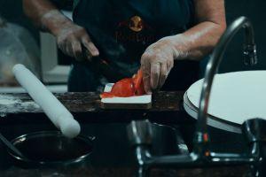 kitchen tomato slicing food hands