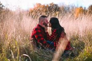 love engagement pictures couple flanel grass jeans noses touching long hair field married