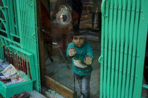mirror monochromatic reflections green kid door reflection mint green street street photography