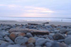 nature rocks beach seashore waves ocean summer horizon scenic vacation