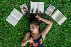 posing pose reader attractive woman opened person books words hair