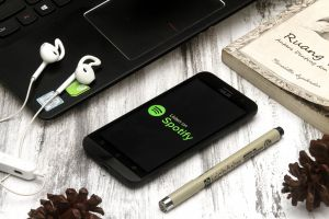 reading spotify smartphone product photography wood details grey product shot flat lay simple earphone