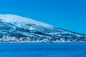red houses troms norway fjords snow blue hour arctic sea tromso moutains winter