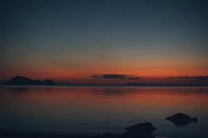 reflection ocean sunset sea golden hour sky landscape scenic beach clouds