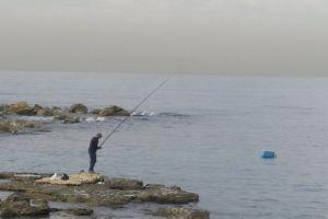 sea mediterranean sea fishing water rocks fisherman