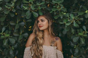 shrubs bushes looking away attractive red lips photoshoot tattooed stems woman pose